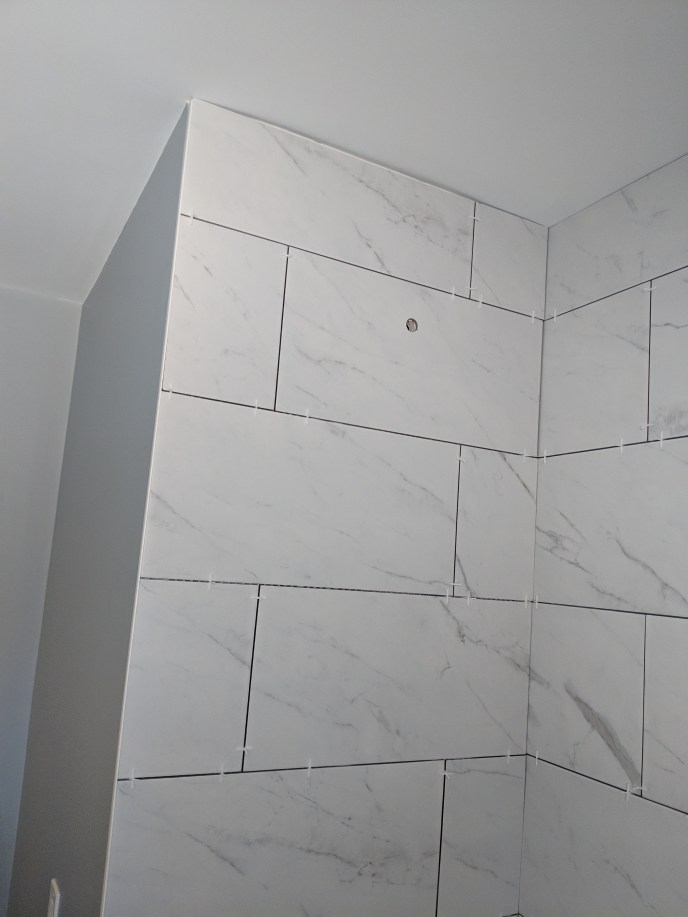 New tiles installed over tub