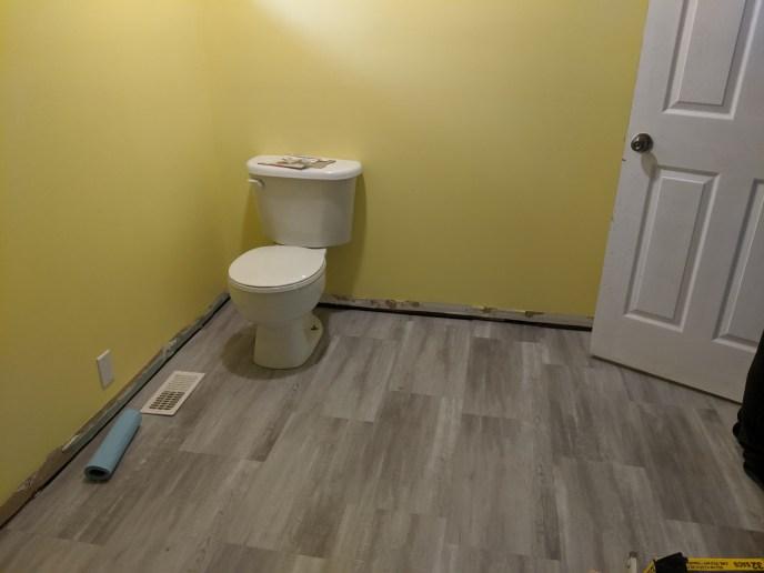 New floor installed in enlarged bathroom
