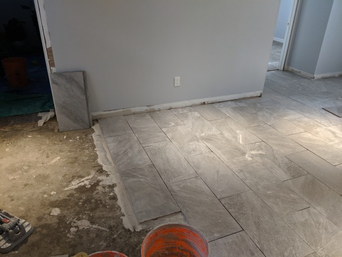 TIles being installed in basement