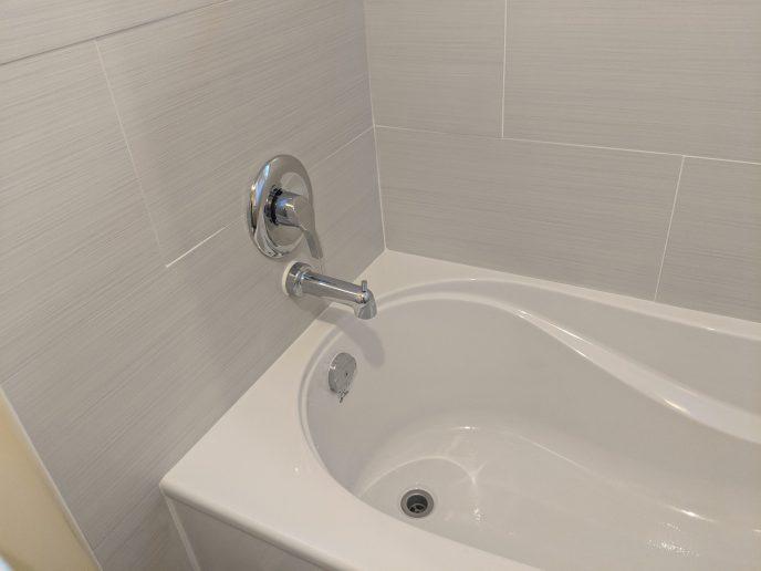 New bathtub and tiled bath surround installed