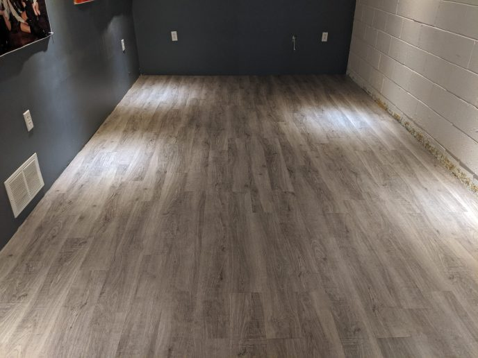 Luxury vinyl flooring installed in basement