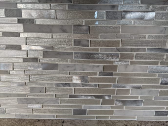 Tiled back splash installed