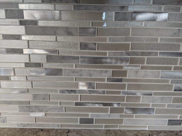 Tiled back splash installed