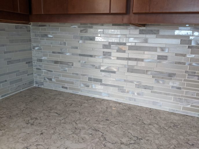 Kitchen back splash installed, counter caulked