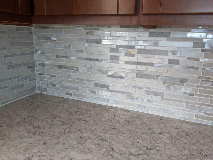 Kitchen back splash installed, counter caulked