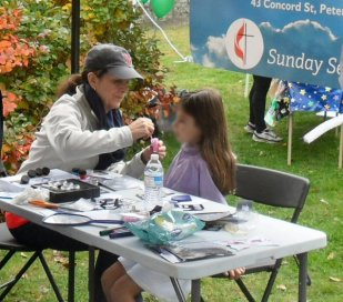 Face painting at Peak Into Peterborough