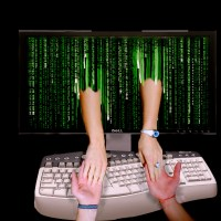 Picture of arms reaching out of a computer monitor and holding hands with a person writing a blog