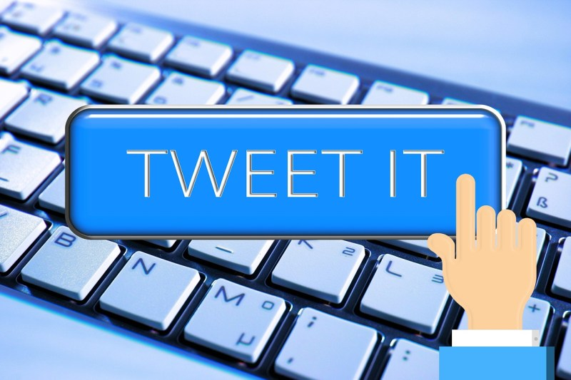 "Keyboard with the command ""Tweet It"" displayed above it"