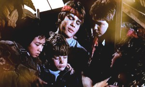 Goonies reading the map before heading out on the adventure