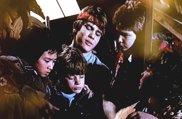 The Goonies reading a map together