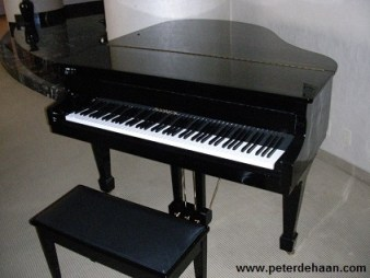 Baby grand piano in hotel suite