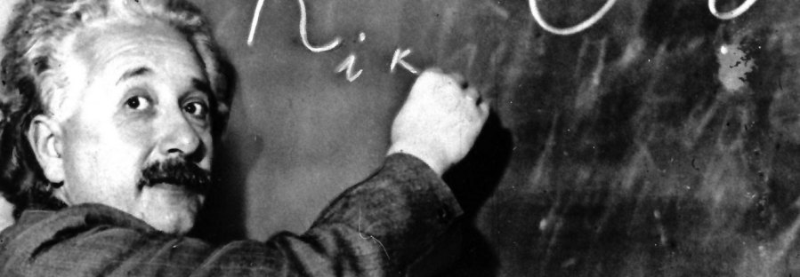 Albert Einstein writing General Relativity equations on a blackboard