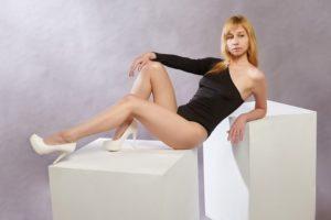 a woman in a bodysuit