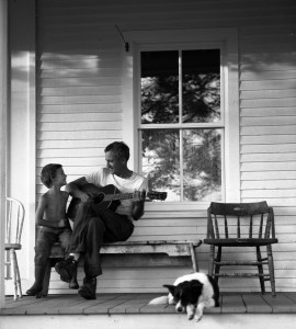 George & Henry Woodard on the porch of their farmhouse