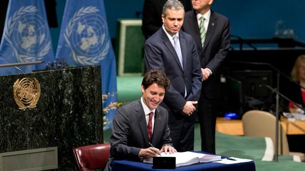 Trudeau signing Paris accord 22 Apr 16 Mary Altaffer-AP