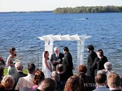 A boat cruises along Oneida Lake during Dan & Crystal's wedding ceremony