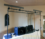 Mixing console and lighting truss in place.