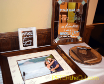 "Guests signed a picture frame and were asked to leave some ""bucket list"" thoughts for the newlyweds"