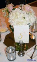 Table centerpieces at Andrea and Larry's wedding reception at Turning Stone, Verona, NY