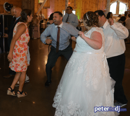 Dancing at Kimberly and Giovanni's wedding at Wolf Oak Acres in Oneida, NY, June 2018