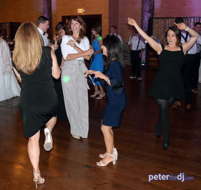 Guests dancing at Emily and Nick's wedding at Tailwater Lodge, Altmar, NY. Photo by DJ Peter Naughton. October 2018