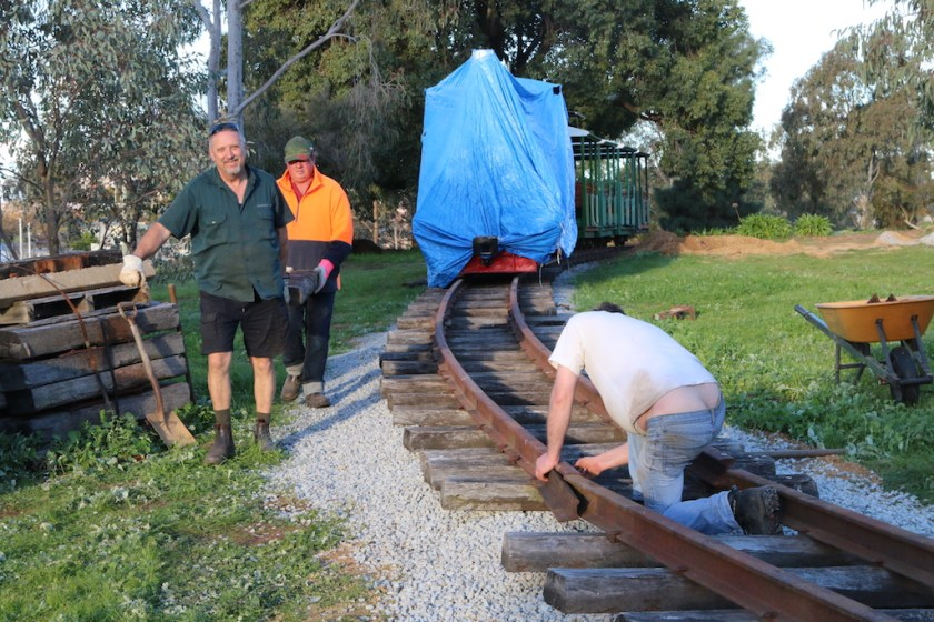 "2016-3444: Ben places the fishplate into position and inserts the bolts, Mario and Rob bring down one of the spare sleepers to replace one which has dropped out of the ""set-track"""