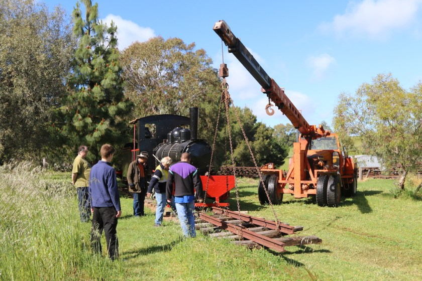 Image 2016.4464 – There are a considerable number of on lookers as Mario (in the crane) places a short length of track in front of the Perry loco. Ben (in the purple-topped sweater) is actually assisting Mario, while (from the left) Nick, Rhys, Lenny and Gordon supervise.    Sounds about right!