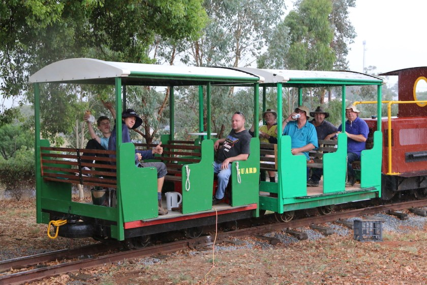 Image 2017.1255: Many of the PHR volunteers have taken a few minutes out in the two carriages for a lunch break. There's Rhys, Josh, Ben, Claude, myself (with a drink flask to my mouth!) Phil and Rob. Note the extension power cord, run down from the house, so that the kettle could be boiled for cups of tea! I really do owe my thanks to these guys (and the others who didn't get into the photo) for without them, Pete's Hobby Railway would not be where it is today. By a process of elimination, we reckon that the photo was taken by Lenny, using my camera! The date was Wednesday, 3rd February.