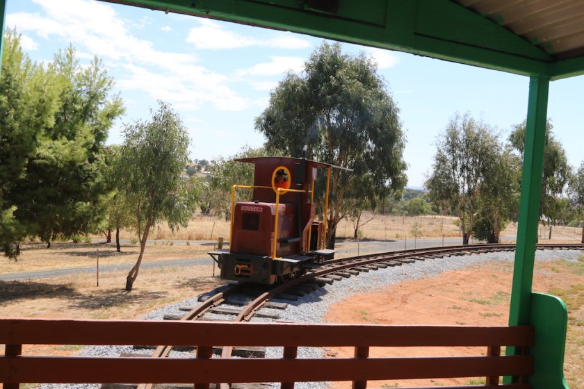 Image 2017.1793: With Ben in charge, the Ruston slows as it approaches the rear of the stopped train. It will then couple for the return journey through the platform to the southern terminus.