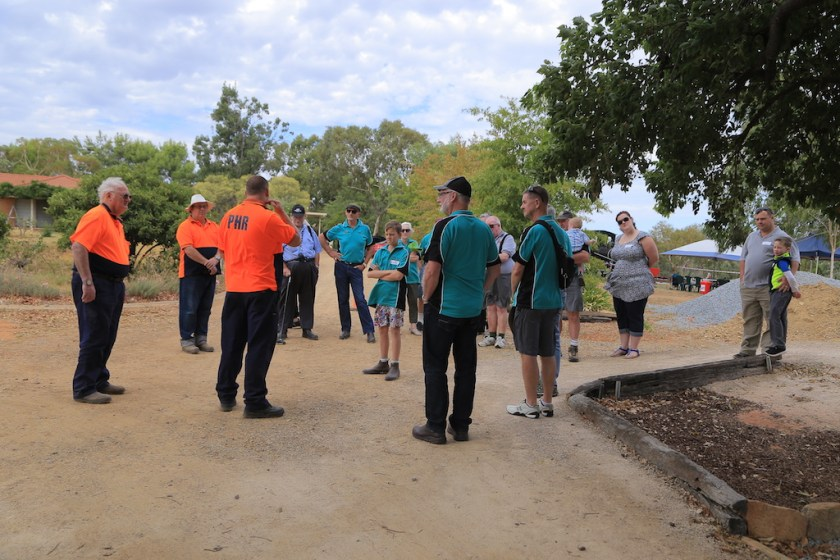 Image Joel 2375: Rod any I look on as Dave (back to camera) goes through the basic track awareness and safety briefing to the Wagga group.