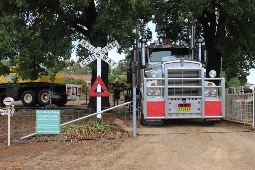 Image 3960: Mario's vintage Kenworth only just fits through the canopy of the two Kurrajong trees and the apparently narrow driveway gate – but being the seasoned driver he is, neither were scratched!