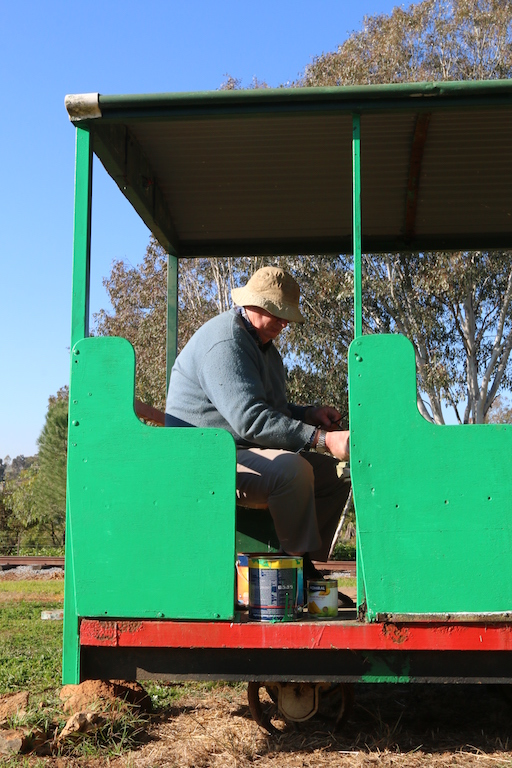 Image 2017.3042: I'm sitting down on the job, working on the cosmetic restoration of the third carriage, when Rhys borrowed my camera. Sunday, 18/6/2017.