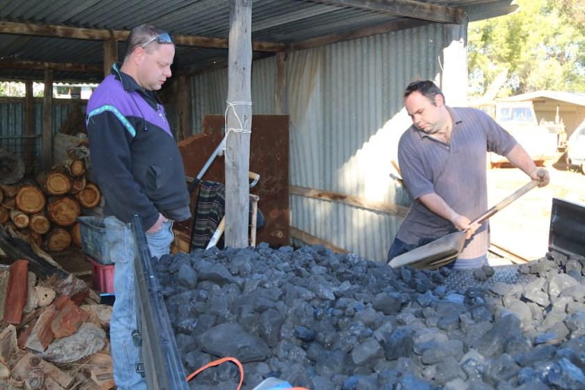 Image 2017.4093: Ben supervises as Matt shovels coal from his utility truck. Monday 28/08/2017.