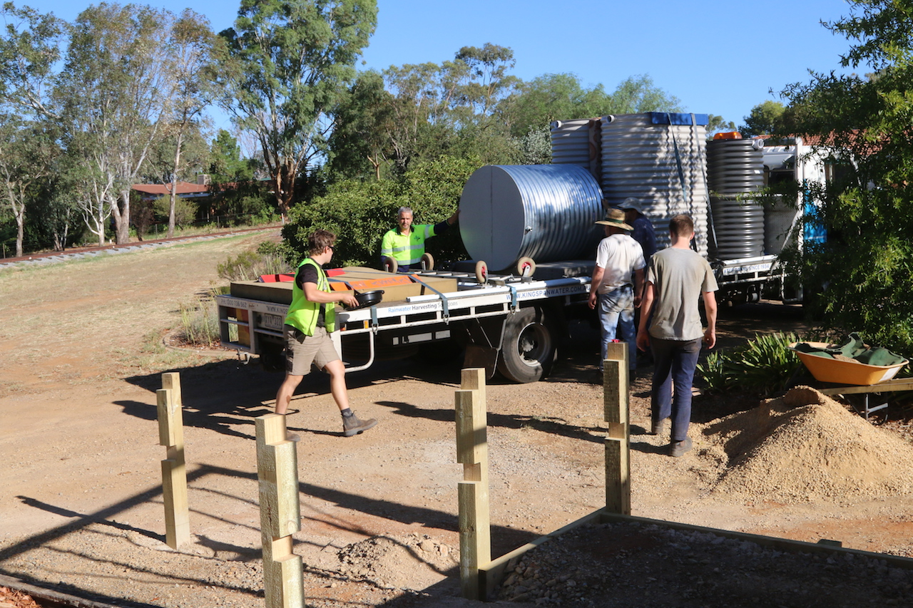 Image 2018.0292: Some weeks later than anticipated, our galvanised iron water tank is delivered from Melbourne... note that all other tanks are plastic! Heritage must be followed! The first uprights for the platform fencing are now in place. Tuesday, 6th March 2018.