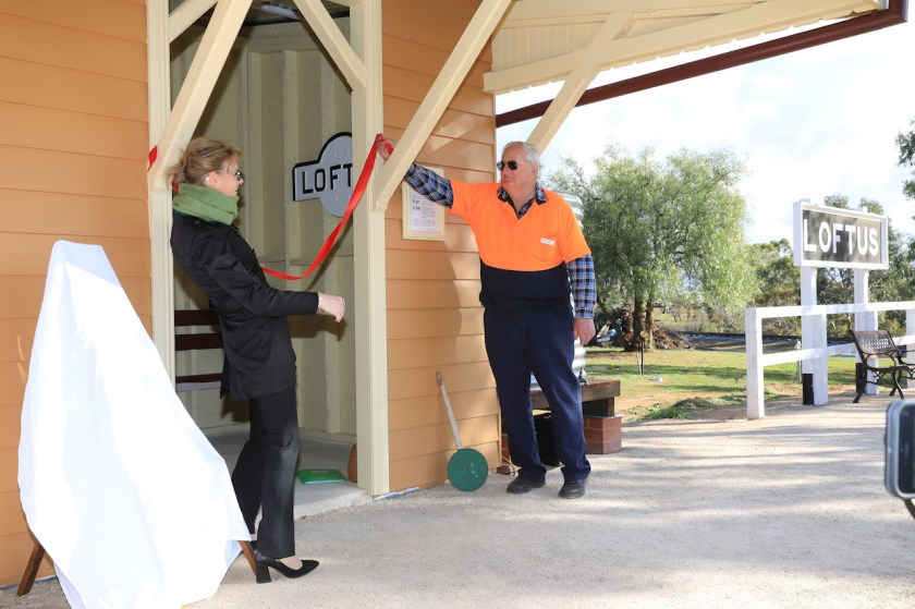 Image 4. Steph and I officially open the new waiting shed. Partially visible on an internal wall is a nameplate from the existing Loftus station in Sydney.