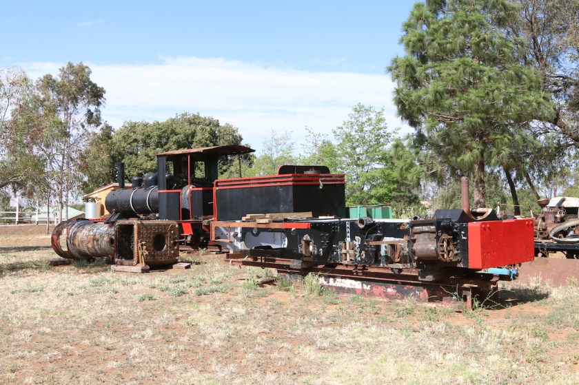 """Image 2019.2876: The Fowler frame and boiler wait for a recommencement of the overhaul. In the background is the Perry 0-6-2T """"Chiverton"""" from Kalamia Sugar Mill, but rescued from a local Park. The tender, originally from a Hudswell Clarke, was last used in 1965 behind the Fowler to increase its operating range. Junee is in summer drought conditions! Photo taken on 29/11/2019."""