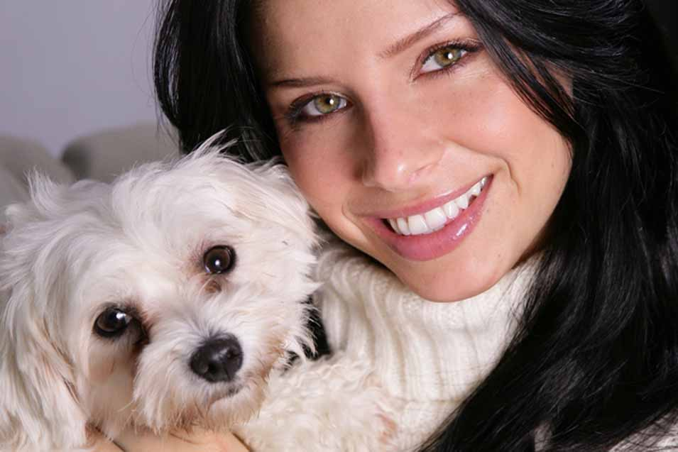 Picture of a Maltese dog and a woman