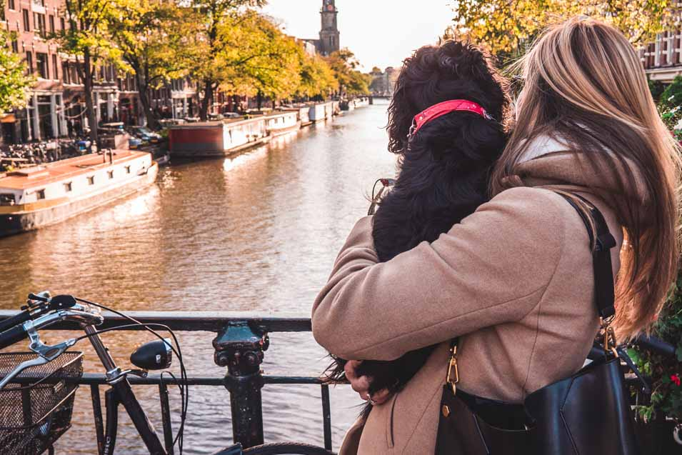Picture of a woman holding a dog in Amsterdam