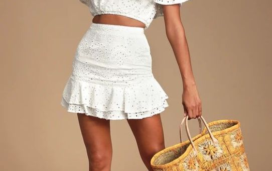 SAN SEBASTIAN WHITE EYELET LACE OFF-THE-SHOULDER CROP TOP &  PLAYA DE ISLA WHITE EYELET LACE RUFFLED MINI SKIRT