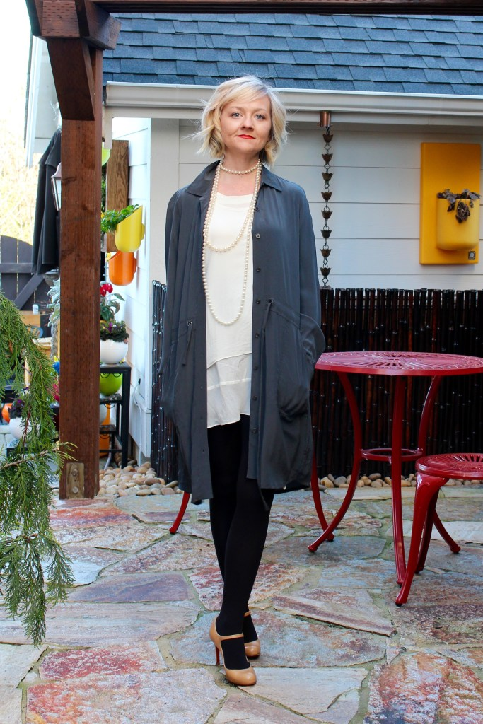 1920s-inspired Valentine's Day outfit -- an unstructured gray Eileen Fisher shirt dress unbuttoned to reveal an ivory slip dress beneath. Paired with gray tights and beige, high heel Christian Louboutin mary janes.