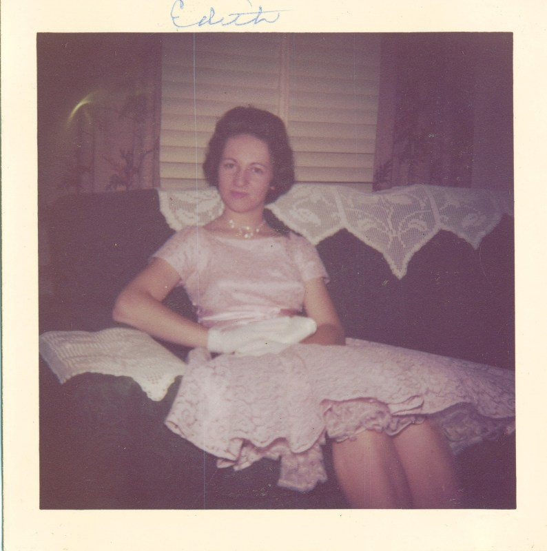 My mom dressed in 1950s-era pink lace, gloves, and pearls.