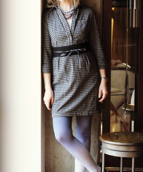 black and gray gingham shirt dress from TheRealReal paired with blue ombre tights, an obi belt and loafers.