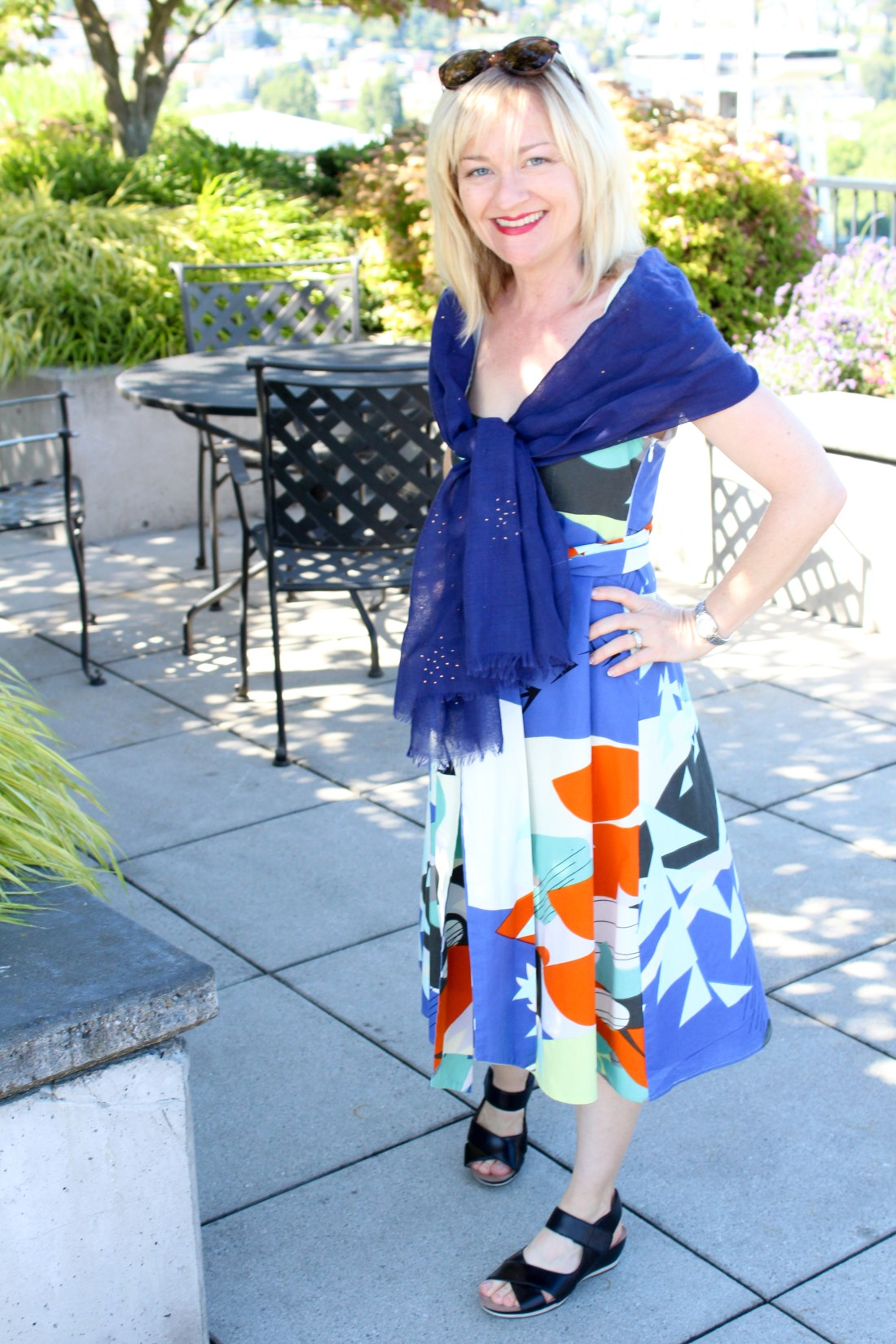 marimekko dress with blue scarf, sandals, and sunglasses