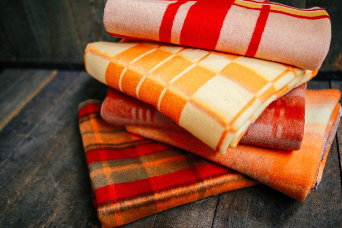 Bright vintage army blankets from Poland at the Federal Army Navy Surplus in Seattle.