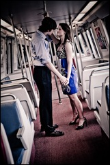 man and woman standing in metro car