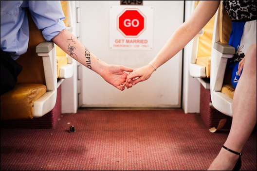 couple holding hands on dc metro car