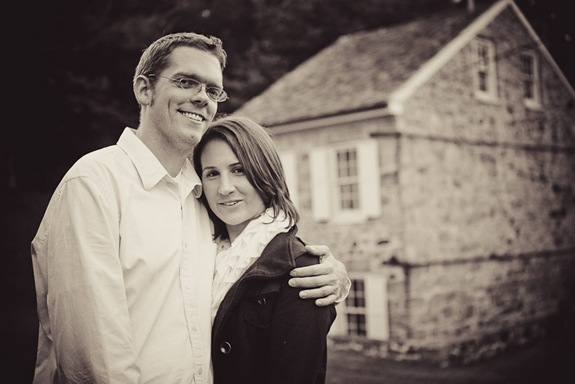 man and woman in Ellicott City in front of old building