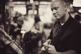 Randy Morser playing guitar in annapolis bar