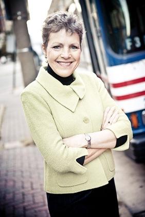 woman standing in front of metrobus  in fairfax va