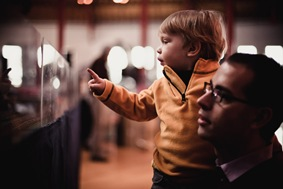Boy looking at toy trains at Baltimore & Ohio Railroad Museum